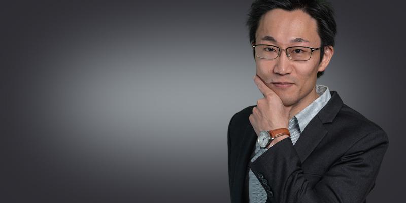Porträttbild på Susumu Okazawa